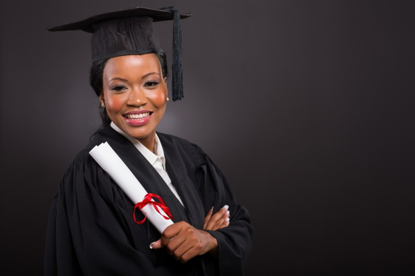 portrait of beautiful young african american graduate holding diploma